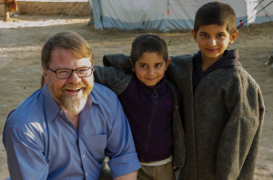 Patrick Ball with Yezidi boys at an informal camp in Sharya, Iraq.