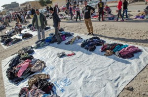 Sorting clothing at a Yezidi camp.