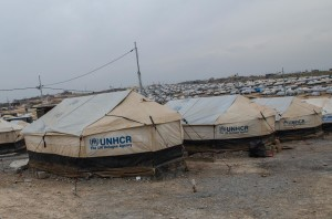 Formal camp with running water and electricity, where tents are built on concrete pads.